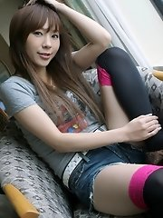 Adorable Asian teen in short shorts